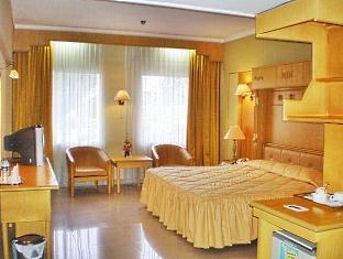 King room at Inna Dharma Deli Hotel Medan